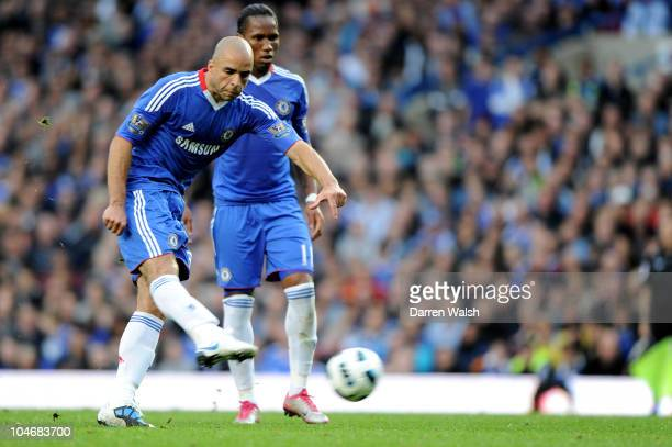 Alex of Chelsea scores their second goal from a free kick during the Barclays Premier League match between Chelsea and Arsenal at Stamford Bridge on...