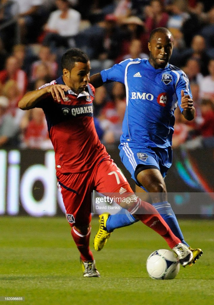 Alex #71 of Chicago Fire is defended by Nelson Rivas #2 of Montreal Impact in an MLS match on September 15, 2012 at Toyota Park in Bridgeview, Illinois.
