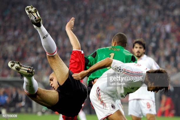 Alex of Eindhoven in action against goalkeeper Dida and Alessandro Nesta of Milan during the Champions League semi final second Leg match between PSV...
