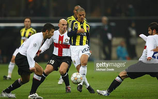 Alex of Fenerbahce takes on Esteban Cambiasso Walter Samuel and Cristian Chivu of Inter during the UEFA Champions League Group G match between Inter...