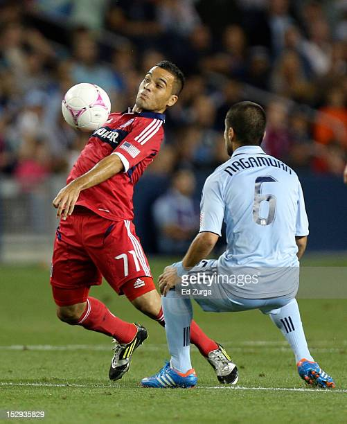 Alex of the Chicago Fire controls the ball against Paulo Nagamura of the Sporting Kansas City in the first half at Livestrong Sporting Park on...