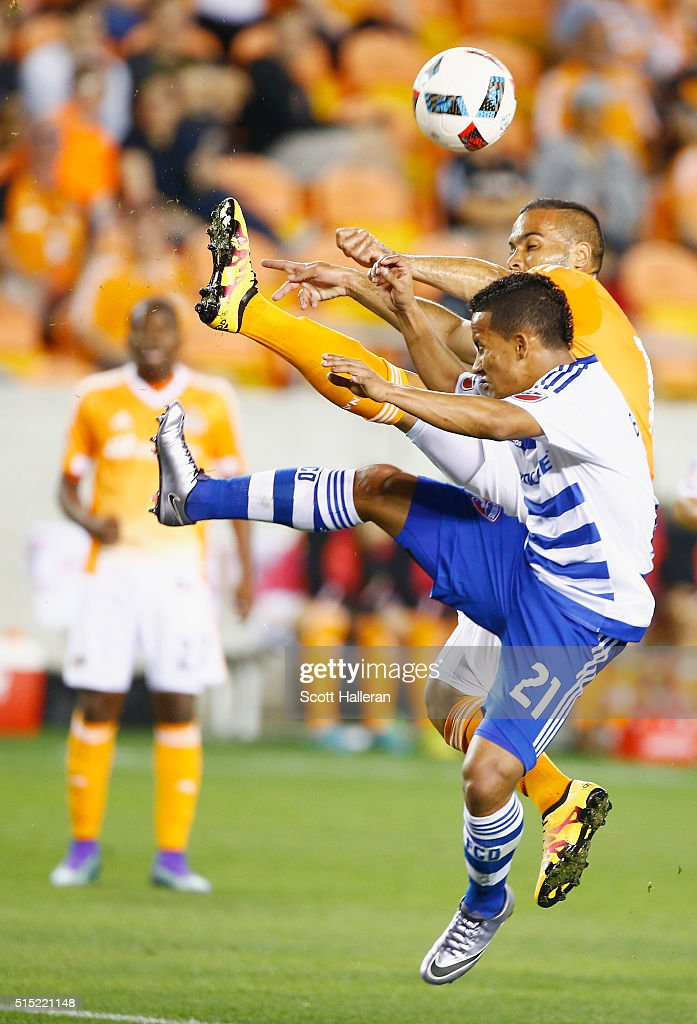Alex #14 of the Houston Dynamo battles for the ball with Michael Barrios #21 of FC Dallas during their game at BBVA Compass Stadium on March 12, 2016 in Houston, Texas.