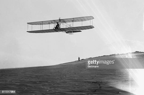 Alex Ogilvie watches Orville Wright glide over the Kill Devil Hills,