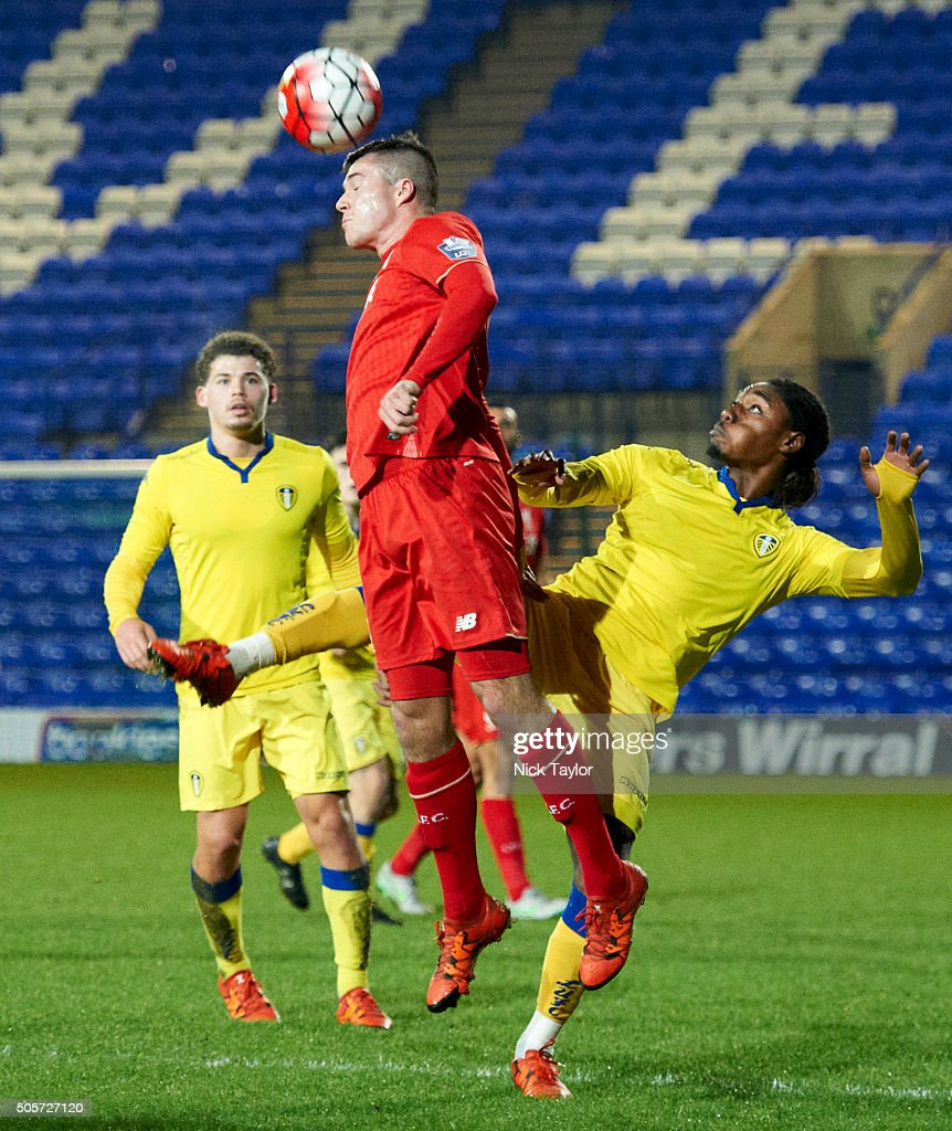 Alex O'Hanlon of Liverpool and Jordan Botaka of Leeds United in action during the Liverpool v Leeds United U21 Premier League Cup game at Prenton Park on January 19, 2016 in Birkenhead, England.