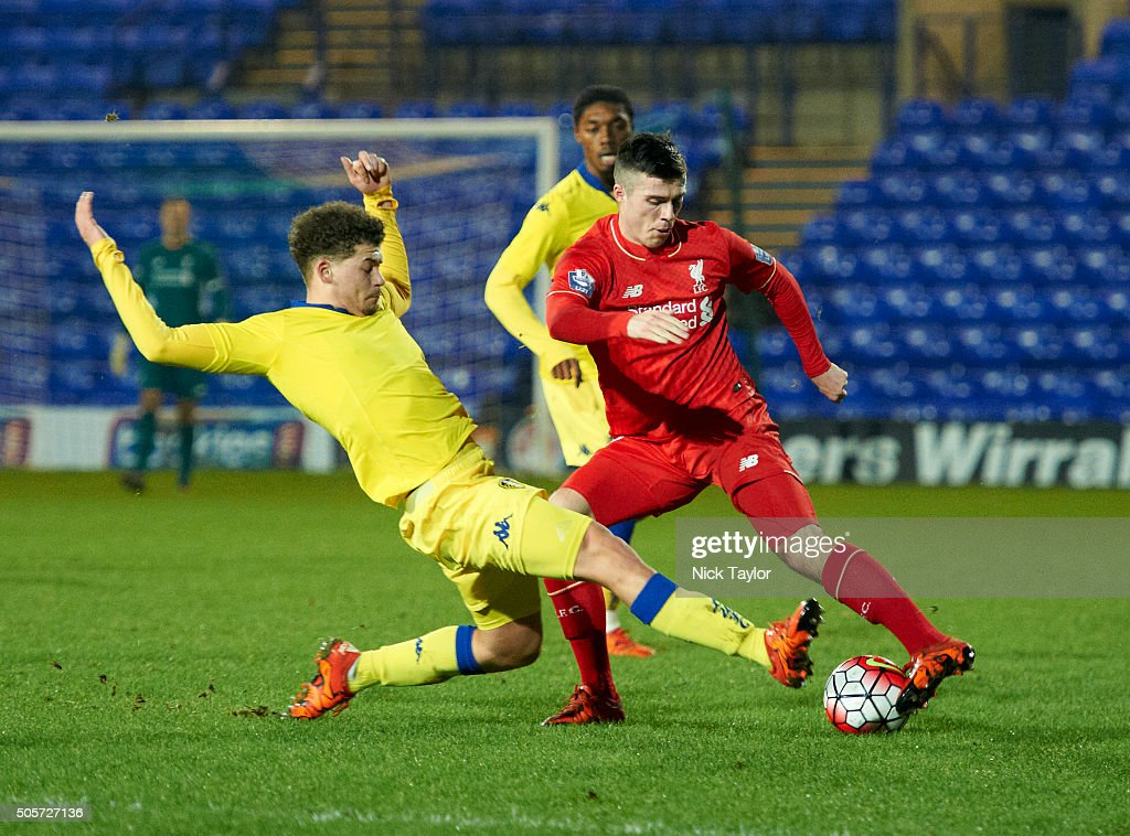 Alex O'Hanlon of Liverpool and Kalvin Phillips of Leeds United in action during the Liverpool v Leeds United U21 Premier League Cup game at Prenton Park on January 19, 2016 in Birkenhead, England.