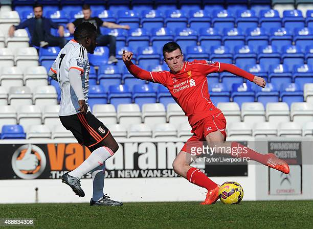 Alex O'Hanlon of Liverpool and Larnell Cole of Fulham in action during the U21 Premier League game between Liverpool and Fulham at The Swansway...