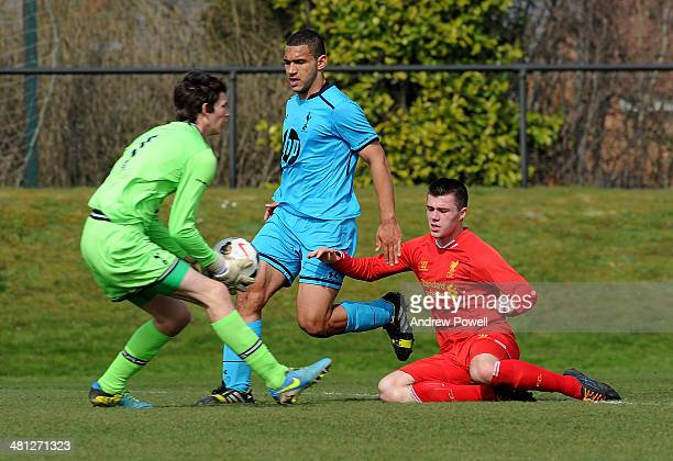 Alex O'Hanlon of Liverpool competes with Liam Priestly and Cameron Carter Vickers of Tottenham Hotspur during at Barclays Under 18 League match...