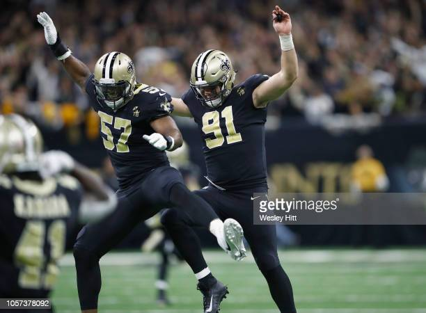 Alex Okafor and Trey Hendrickson of the New Orleans Saints celebrate after stopping the Los Angeles Rams on their fourth down during the fourth...