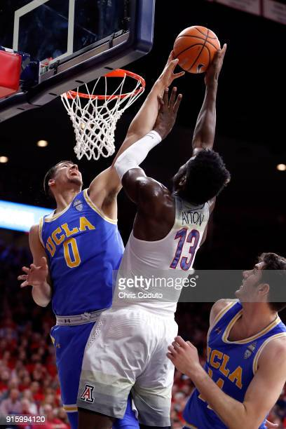 Alex Olesinski of the UCLA Bruins blocks a shot by Deandre Ayton of the Arizona Wildcats during the second half of the college basketball game at...