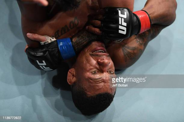 Alex Oliveira of Brazil grapples with Mike Perry in their welterweight bout during the UFC Fight Night event at BB&T Center on April 27, 2019 in...