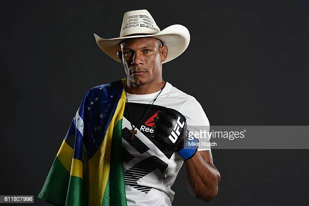 Alex Oliveira of Brazil poses for a post fight portrait backstage after defeating Will Brooks during the UFC Fight Night event at the Moda Center on...