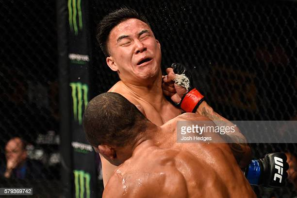 Alex Oliveira of Brazil punches James Moontasri in their welterweight bout during the UFC Fight Night event at the United Center on July 23, 2016 in...
