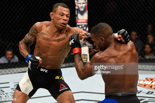 Alex Oliveira of Brazil punches Will Brooks in their lightweight bout during the UFC Fight Night event at the Moda Center on October 1 2016 in...