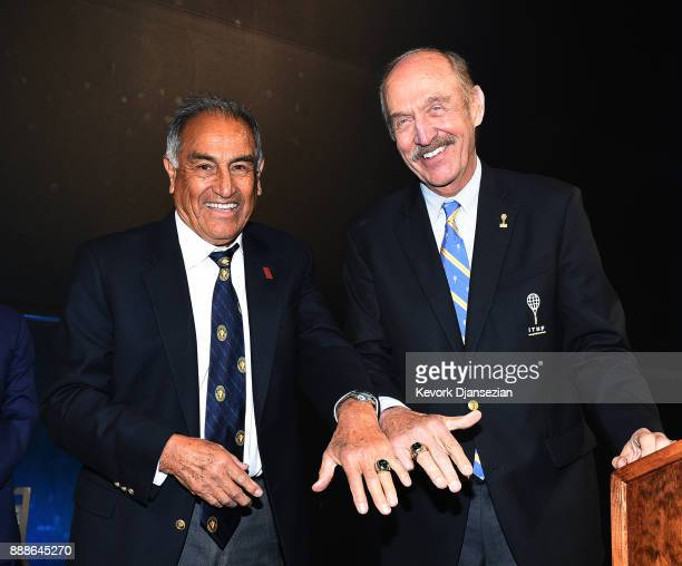 Alex Olmedo and Stan Smith show their International Tennis Hall Fame rings during a ceremony at the Los Angeles Tennis Club on December 8 2017 in Los...