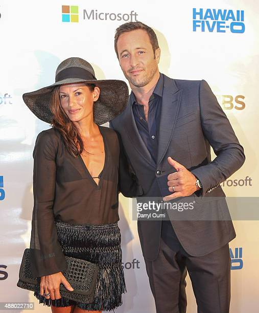 Alex O'Loughlin and his wife Maila Jones arrive at the CBS 'Hawaii Five0' Sunset On The Beach Season 6 Premire Event at Queen's Surf Beach on...