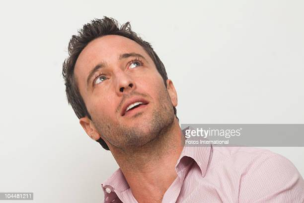 Alex O'Loughlin poses for a photo during a portrait session at the Four Seasons Hotel in Beverly Hills California on March 28 2010 Reproduction by...