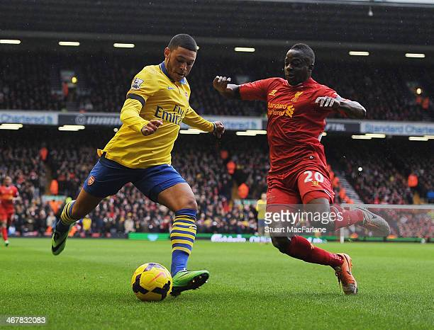 Alex Olxade-Chamberlain of Arsenal is challenged by Aly Cissokho of Liverpool during the Barclays Premier League match between Liverpool and Arsenal...