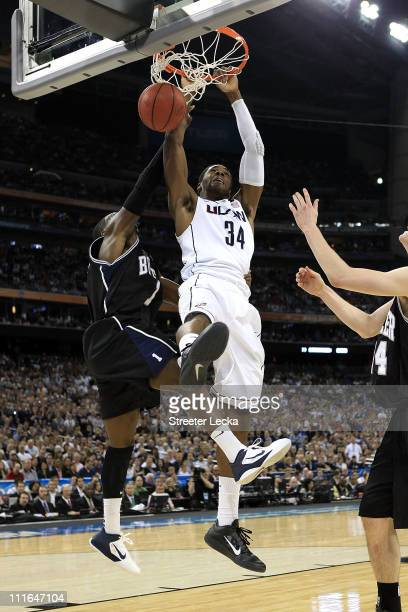 Alex Oriakhi of the Connecticut Huskies dunks the ball against Shelvin Mack of the Butler Bulldogs during the National Championship Game of the 2011...