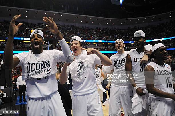 Alex Oriakhi Tyler Olander Charles Okwandu and Kemba Walker of the Connecticut Huskies celebrates after defeating the Arizona Wildcats during the...