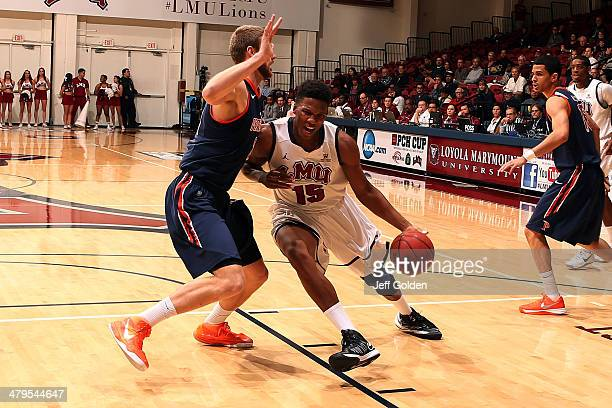Alex Osborne of the Loyola Marymount Lions drives against Brendan Lane of the Pepperdine Waves in the first half of the game at Gersten Pavilion on...