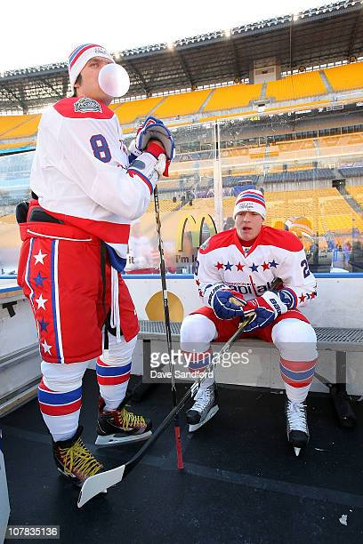 Alex Ovechkin and Alexander Semin of the Washington Capitals sit in the penalty box as they have a bubble blowing contest during practice for the...