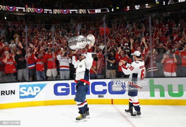Alex Ovechkin and Andre Burakovsky of the Washington Capitals celebrate winning the Stanley Cup by defeating the Vegas Golden Knights 43 in Game Five...