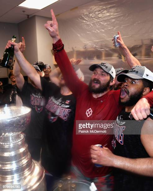 Alex Ovechkin and Devante SmithPelly of the Washington Capitals celebrate with the Stanley Cup in the locker room after they defeated the Vegas...