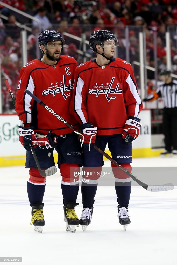 Alex Ovechkin #8 and Evgeny Kuznetsov #92 of the Washington Capitals talk on the ice against the Columbus Blue Jackets during Game Two of the Eastern Conference First Round during the 2018 NHL Stanley Cup Playoffs at Capital One Arena on April 15, 2018 in Washington, DC.