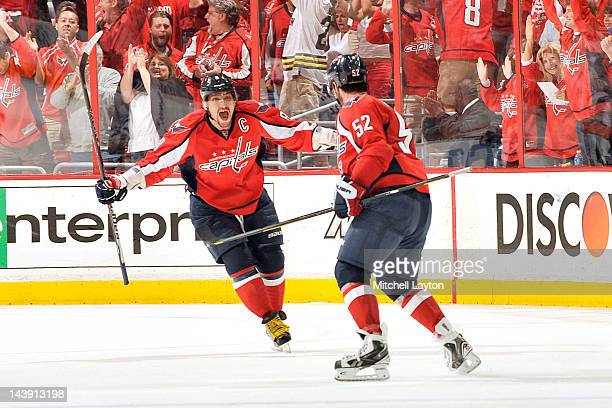 Alex Ovechkin and Mike Green of the Washington Capitals celebrate their third goal during the third period of Game Four of the Eastern Conference...