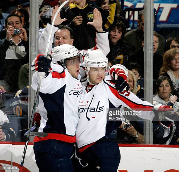 Alex Ovechkin and Mike Green of the Washington Capitals celebrate Ovechkin's goal in the first period against the Buffalo Sabres on March 5, 2008 at...