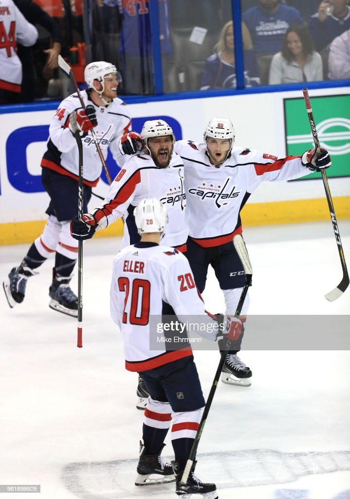 Alex Ovechkin #8, Andre Burakovsky #65, Lars Eller #20 and John Carlson #74 the Washington Capitals celebrate after defeating the Tampa Bay Lightning in Game Seven of the Eastern Conference Finals during the 2018 NHL Stanley Cup Playoffs at Amalie Arena on May 23, 2018 in Tampa, Florida. The Washington Capitals defeated the Tampa Bay Lightning with a score of 4 to 0.