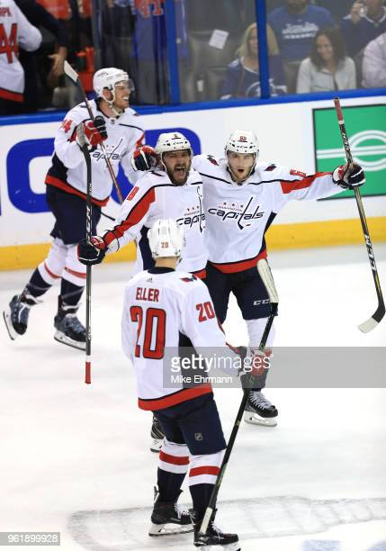 Alex Ovechkin Andre Burakovsky Lars Eller and John Carlson the Washington Capitals celebrate after defeating the Tampa Bay Lightning in Game Seven of...