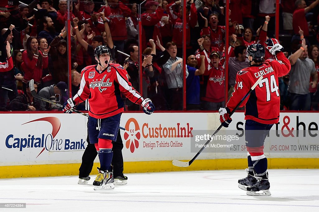 Alex Ovechkin #8 celebrates with John Carlson #74 of the Washington Capitals celebrates after scoring a goal in the third period against the San Jose Sharks during an NHL game at Verizon Center on October 14, 2014 in Washington, DC.