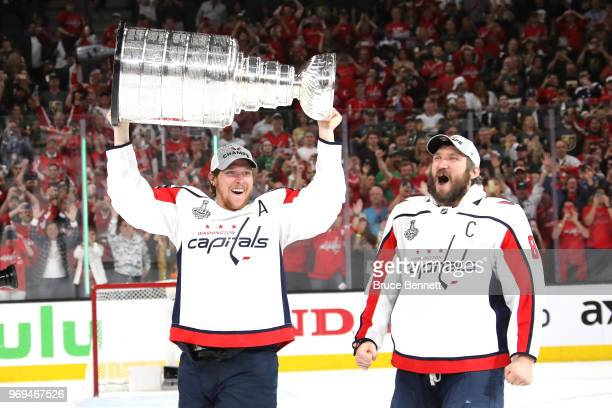 Alex Ovechkin hands of the Stanley Cup to Nicklas Backstrom of the Washington Capitals after their team's 43 win over the the Vegas Golden Knights in...