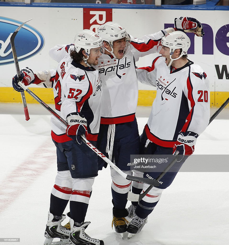 Alex Ovechkin #8 is congratulate by Mike Green #52 and Troy Brouwer #20 of the Washington Capitals after he scored a goal in the third period to tie the game against the Florida Panthers and send the game to overtime at the BB&T Center on February 12, 2013 in Sunrise, Florida. The Capitals defeated the Panthers 6-5 in overtime.