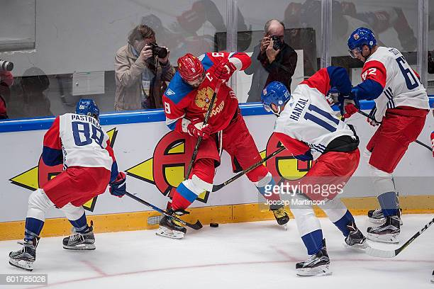 Alex Ovechkin of Team Russia fights for the puck against Czech players during a friendly match between Team Russia and Team Czech Republic at...