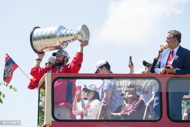 Alex Ovechkin of the NHL champion Washington Capitals hoists the Stanley Cup during a parade down Constitution Avenue on June 12 2018 in Washington DC