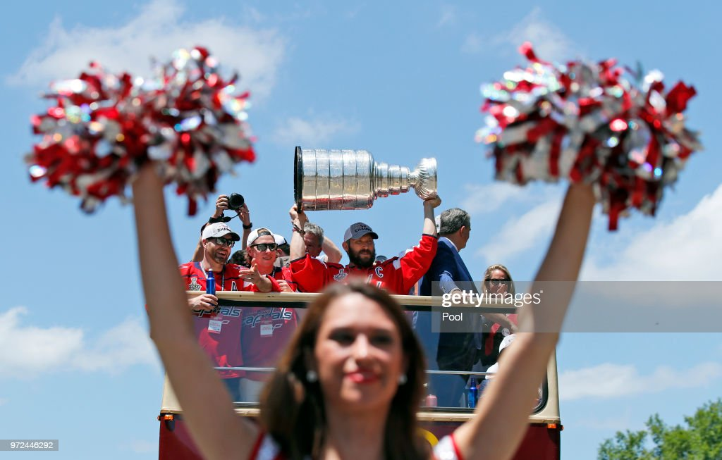 Alex Ovechkin of the NHL champion Washington Capitals holds up the Stanley Cup during a victory parade along Constitution Avenue on June 12, 2018 in Washington, DC.