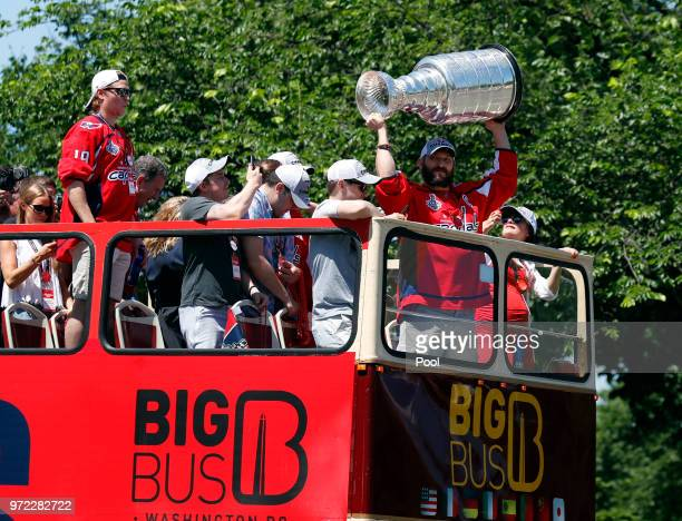 Alex Ovechkin of the NHL champions Washington Capitals holds up the Stanley Cup during a victory parade along Contitution Avenue June 12 in...