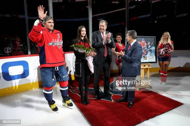 Alex Ovechkin of the Washington Capitals acknowledges the crowd as he is honored for scoring 600 goals before playing against the New York Islanders...
