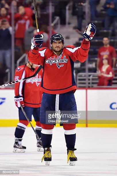 Alex Ovechkin of the Washington Capitals acknowledges the fans and celebrates his 500th career NHL goal in the second period against the Ottawa...
