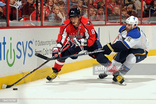 Alex Ovechkin of the Washington Capitals and Barret Jackman of the St Louise Blues fight for the puck during a NHL hockey game on November 29 2011 at...
