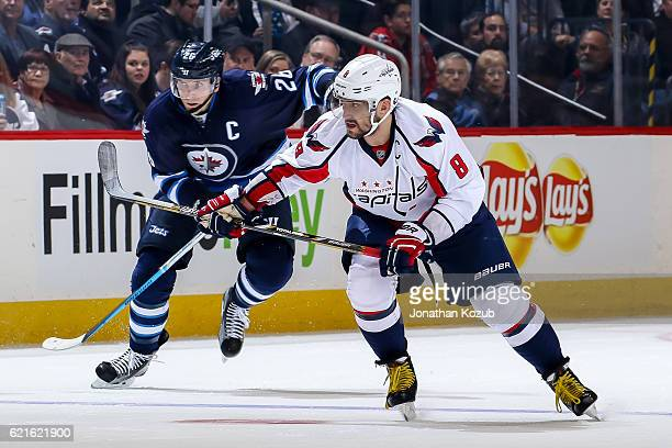 Alex Ovechkin of the Washington Capitals and Blake Wheeler of the Winnipeg Jets follow the play down the ice during second period action at the MTS...