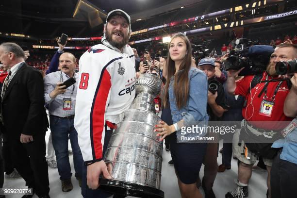 Alex Ovechkin of the Washington Capitals and his wife Anastasia Shubskaya hold the Stanley Cup after the Capitals defeated the Vegas Golden Knights...