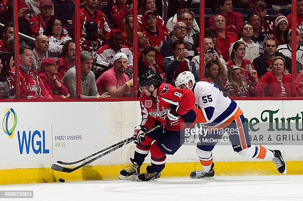 Alex Ovechkin of the Washington Capitals and Johnny Boychuk of the New York Islanders battle for the puck during the third period in Game One of the...