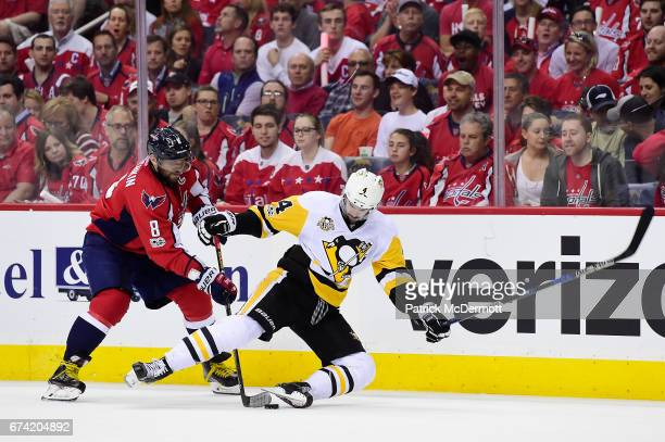 Alex Ovechkin of the Washington Capitals and Justin Schultz of the Pittsburgh Penguins battle for the puck during the third period in Game One of the...