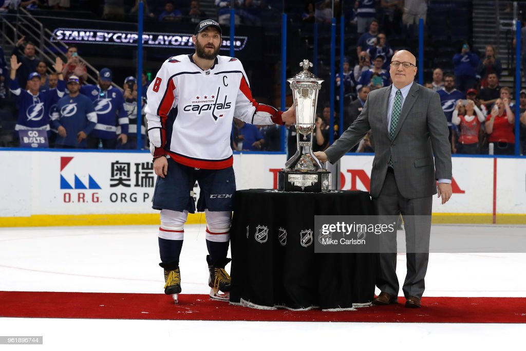Alex Ovechkin #8 of the Washington Capitals and NHL Deputy Commissioner Bill Daly pose with the Prince of Wales Trophy after defeating the Tampa Bay Lightning in Game Seven of the Eastern Conference Finals during the 2018 NHL Stanley Cup Playoffs at Amalie Arena on May 23, 2018 in Tampa, Florida. The Washington Capitals defeated the Tampa Bay Lightning with a score of 4 to 0.