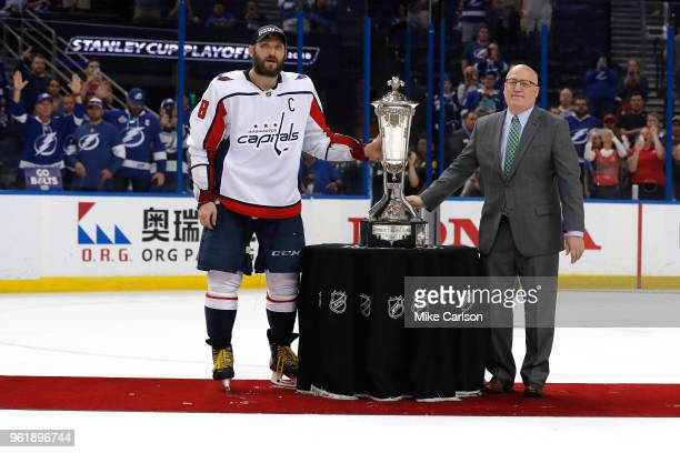 Alex Ovechkin of the Washington Capitals and NHL Deputy Commissioner Bill Daly pose with the Prince of Wales Trophy after defeating the Tampa Bay...