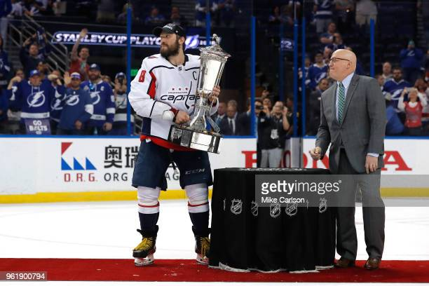 Alex Ovechkin of the Washington Capitals and NHL Deputy Commissioner Bill  Daly pose with the Prince 2d8fab462962