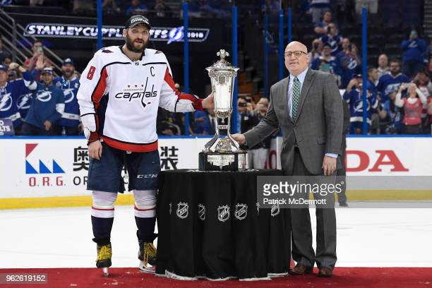Alex Ovechkin of the Washington Capitals and NHL Deputy Commissioner Bill Daly pose with the Prince of Wales Trophy after the Capitals defeated the...
